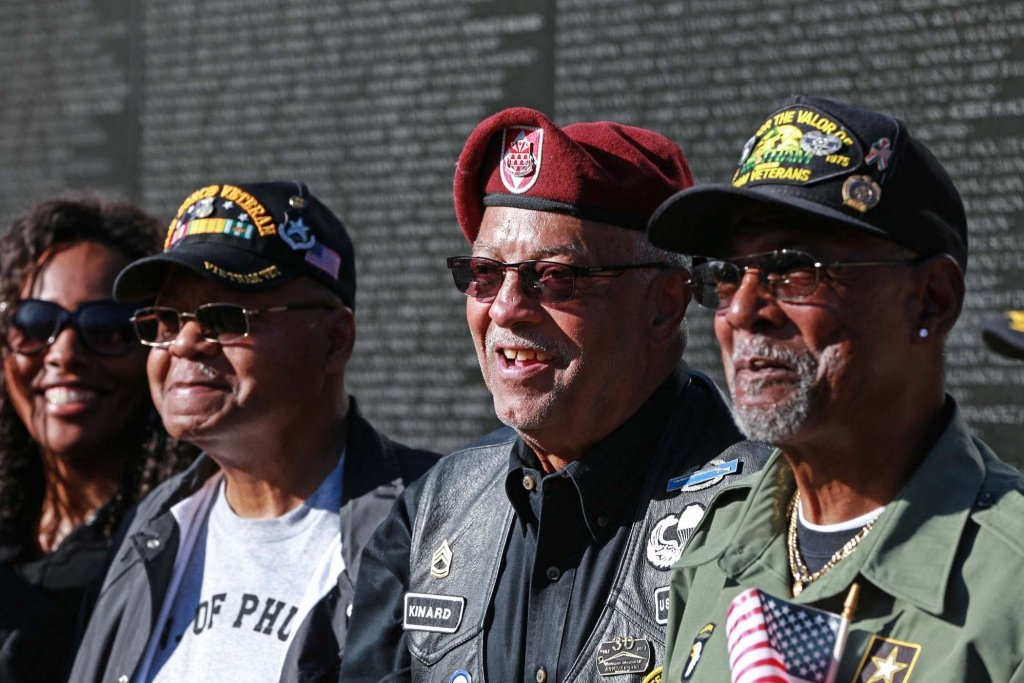 Veterans standing by the Vietnam Memorial Wall in Washington, D.C. Director/CEO Tom Shull played a key role in the building of the wall. To see a video of this story, go to the Exchange Facebook page.(VA/Reynaldo Leal)