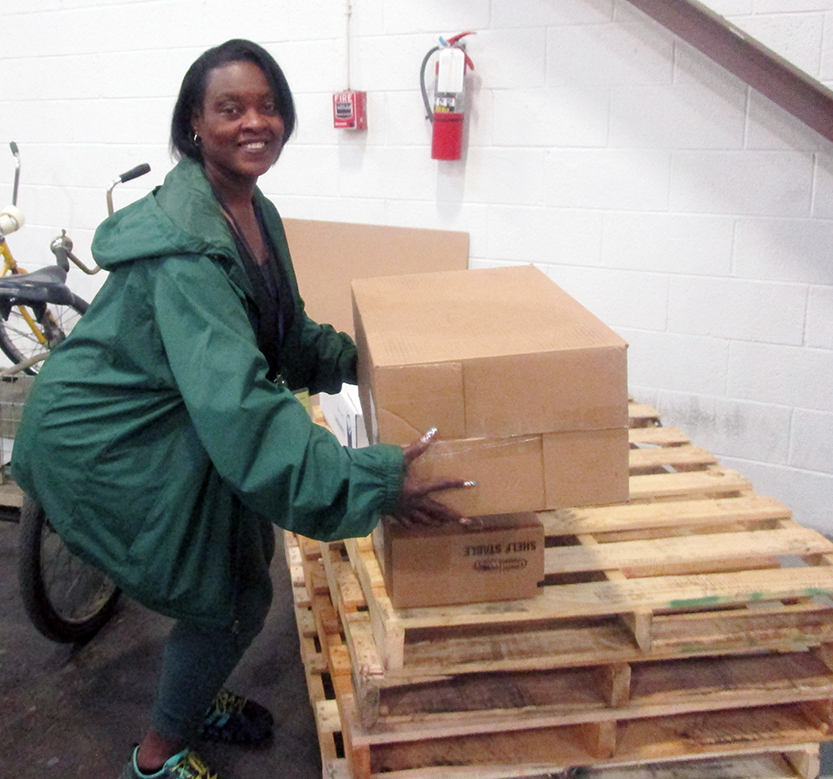 Safe-working challenges motivate associates like Patricia Becton to learn proper techniques, improve the distribution center's efficiency and reinforce physical and cognitive fitness.