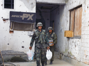 U.S. Soldiers leave an Exchange at Bosnia's Camp Comanche, 1998.