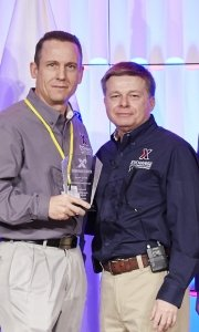 COO Dave Nelson congratulates General Manager Michael Einer on his Exchange winning the COO award at the recent MSM/GM Conference.