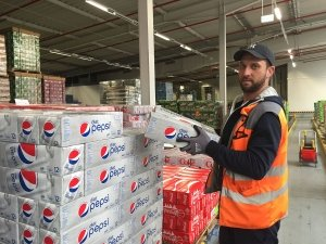 GeDC warehouse associate Derrick Kennedy stocks and picks soda ready to ship to Exchanges and commissaries across Europe.