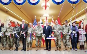 Director/CEO Tom Shull (center), Lt. Gen. Tom Vandal, commanding general, 8th Army, and other Exchange and military leaders ushered in a new shopping experience for Soldiers and families who call Camp Humphreys home.