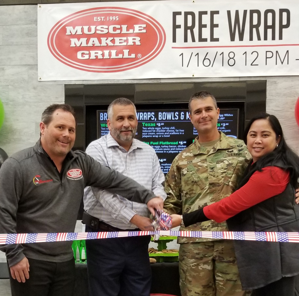 Ribbon-cutting ceremony: Left to right: Mark Farmer, Muscle Maker Grill vice president of operations; Don Sydlik, Exchange general manager; Col. Clinton Cox, Fort Benning garrison commander; and Rutchel Williams, Exchange services business manager.