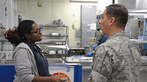 Summer Turner tells Pacific Region Commander Col. Scott Maskery how she operates her school lunchroom.