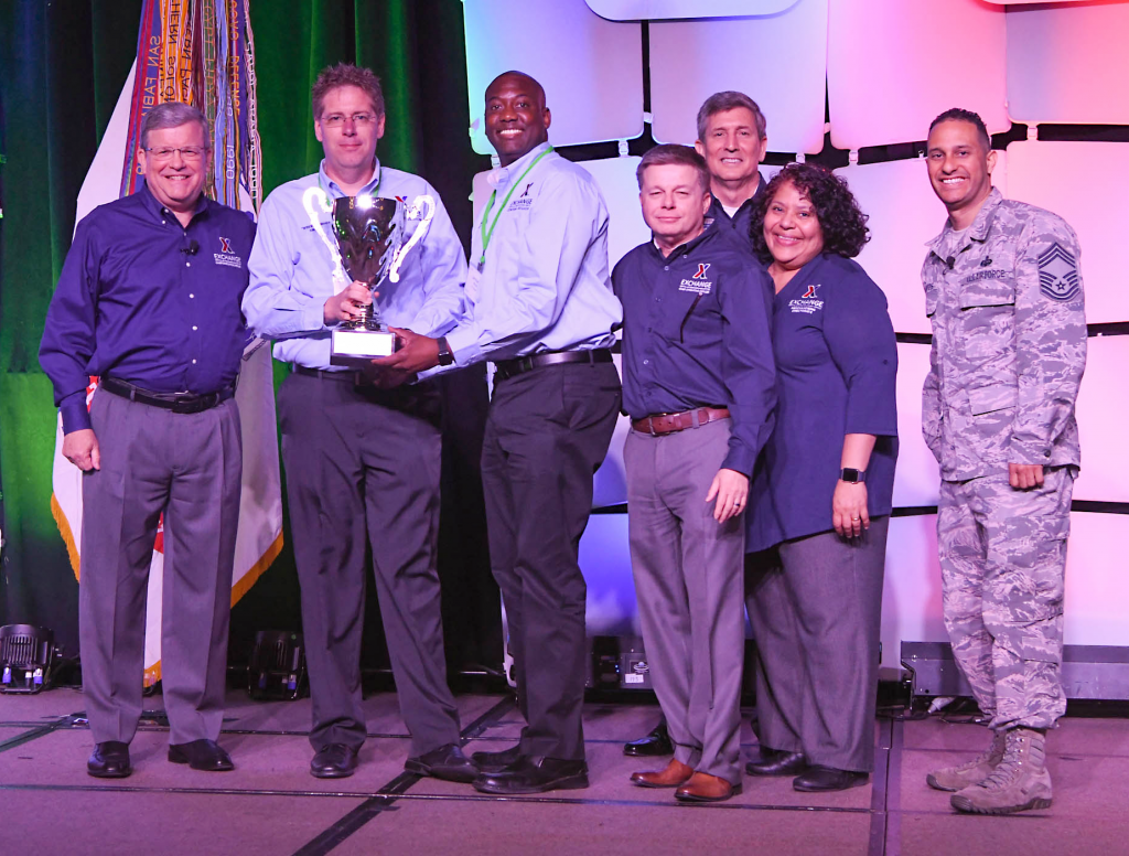 Fort Campbell's Exchange was awarded the Director/CEO Cup in the Super category annual Main Store Managers/General Managers Conference. Pictured (left to right): Exchange Director/CEO Tom Shull; Fort Campbell General Manager David Swenson; Main Store Manager Jermaine Wilson; Chief Operating Officer Dave Nelson; Chief Administrative Officer Phil Stevens; President Ana Middleton; and Chief Master Sgt. Luis Reyes.