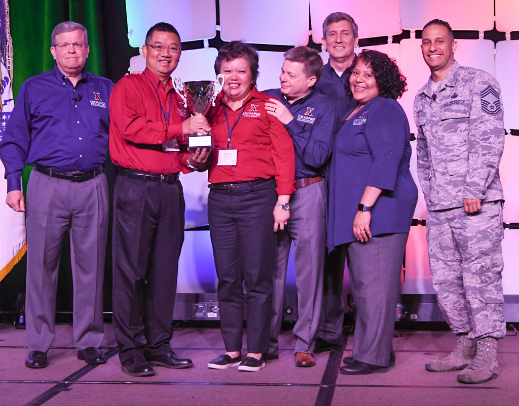 Fort Buchanan's Exchange in Puerto Rico won the Family Serving Family Award at the annual Main Store Managers/General Managers Conference. Pictured (left to right): Exchange Director/CEO Tom Shull; Fort Buchanan General Manager Nicholas Nguyen; Main Store Manager Rochelle Tolentino; Chief Operating Officer Dave Nelson; Chief Administrative Officer Phil Stevens; President Ana Middleton; and Chief Master Sgt. Luis Reyes.