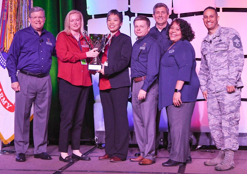 Robins/Moody Exchange was awarded the Director/CEO Cup in the Medium category at the Main Store Managers/General Managers Conference. Pictured (left to right): Exchange Director/CEO Tom Shull; Robins/Moody Exchange General Manager Stephanie Wilson; Robins Exchange Main Store Manager Keola Chan; Chief Operating Officer Dave Nelson; Chief Administrative Officer Phil Stevens; President Ana Middleton; and Chief Master Sgt. Luis Reyes.