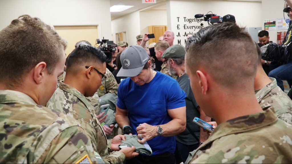 Actor Mark Wahlburg signs autographs at the Fort Benning Exchange during a special visit to greet Soldiers.