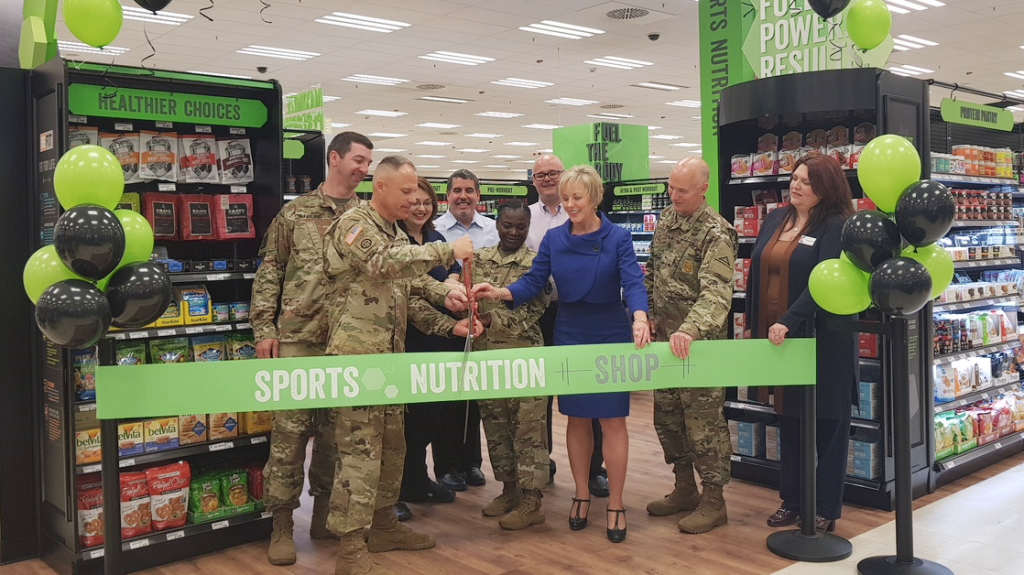 Exchange managers and installation commanders cut the ribbon during the festive grand-opening celebrations.