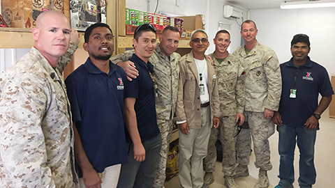 COL John Armellino, commander of the 8th Marine Regiment, center, and his leaders pose with associate Naresh Sethi, and Azamat Narynekov, Exchange Afghanistan GM Robin Chetri, and associate Mustak Ahamed.