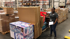 Dan Daniel DC Logistics Operations Manager Alecia Barrett checks one of the first shipments staged for UPS pick up.