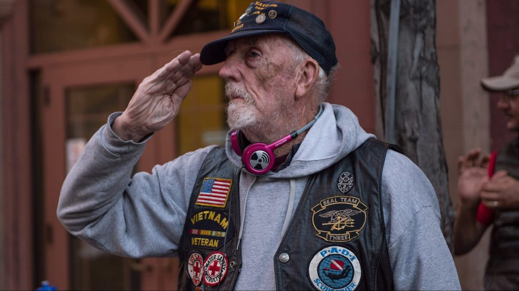 A veteran gives a salute to passing Fairchild Air Force Base Airmen during the annual Armed Forces Torchlight Parade May 20, 2017, in downtown Spokane, Washington. The Lilac Festival began as local club that held annual flower shows until the celebration merged with the newly appointed Armed Forces day in 1949.  (U.S. Air Force Photo / Airman 1st Class Ryan Lackey)
