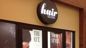 Hair Studio store front and sign.
