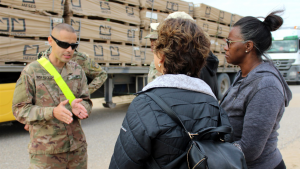 A member of the U.S. Army's 595th Transportation Brigade explains to Exchange logistics leaders from Dallas the intricate process of getting merchandise from Kuwait to the Warfighters in Iraq.