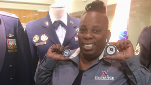 Karen Anderson shows the coins presented to her recently by the Secretary of the Air Force and the Air Force's Chief of Staff.