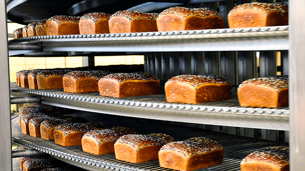 Loaves of bread on rotating shelf in Exchange bakery.