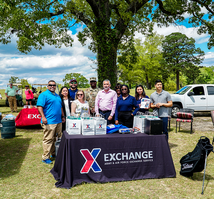 Exchange associates at table at Fort Benning, Ga.