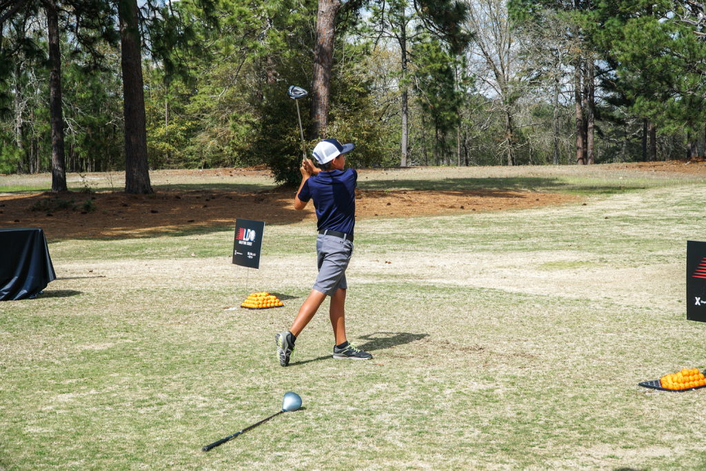 Young golfer swings at Fort Benning, Ga.