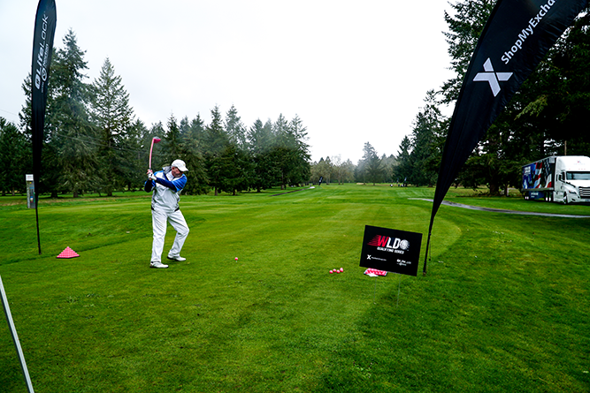 Golfer swings at JB Lewis-McChord, Wash.