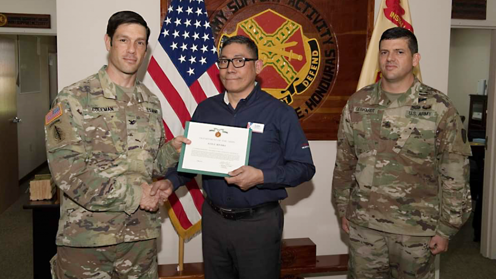 Luis Rivera, Honduras Exchange store manager, receives the Commander's Award for Civilian Service from garrison commander Col. Michael Coleman and Command Sgt. Maj. Jeremy Gebhardt.