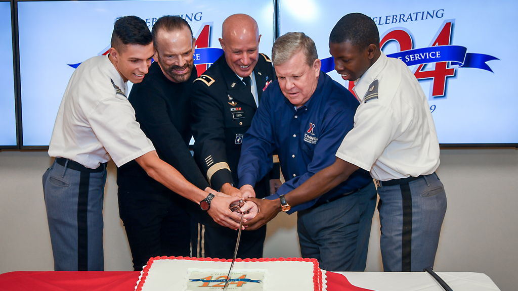 From left, West Point Cadet CPT Christian Faulk; Senior Vice President James Skibo, who recently celebrated 50 years with the Exchange; Commander Maj. Gen. David Coburn, Commanding General of the U.S.  Army Financial Management Command, Director/CEO Tom Shull; and West Point Cadet Thomas Bordeaux cut the ceremonial cake.
