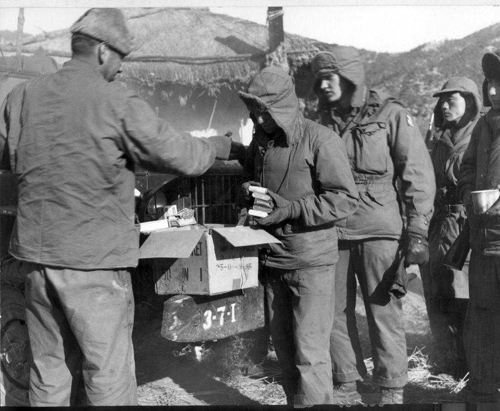 Troops get their PX basic necessities after they emerged from the mountains during the Korean War, 1950.