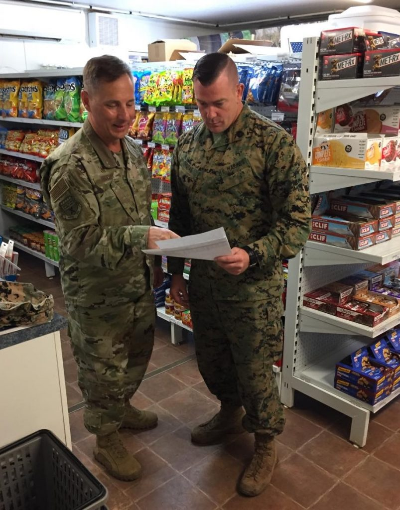 Exchange Pacific Region Commander Col Scott Maskery, left, reviews inventory with GySgt Jonah Thomas at the mobile field exch