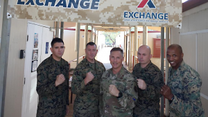 Pacific Pride in Australia! Exchange Pacific Region Commander Col Scott Maskery, center, presents his Commander's Coin to U.S. Marines running the mobile field exchange at Camp Robertson Barracks. From left to right: SGT Angel Mendoza, GySgt Jonah Thomas, MGySgt Christof Coleman and CWO4 Montreal Newkirk.