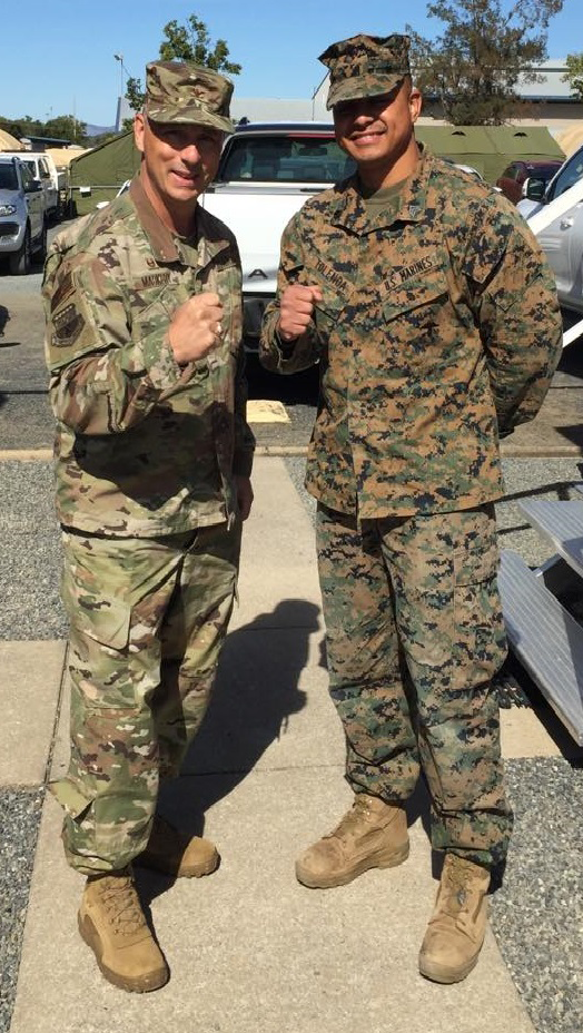 Exchange Pacific Region Commander Col Scott Maskery meets with SGT Jerry Tolenoa, right, who ran a mobile field to support Exercise Talisman Sabre at Australia's Camp Rocky.