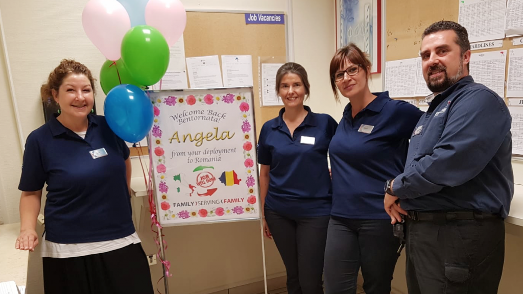 Angela Morson, center, is welcomed back to Aviano AB by, left to right, Linda Vivan, Selena Mazzega and Store Manager Boris Nasci.