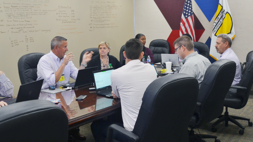 The USTRANSCOM team and Exchange's transportation management experts talk about fine points of getting shipments overseas to their destinations.