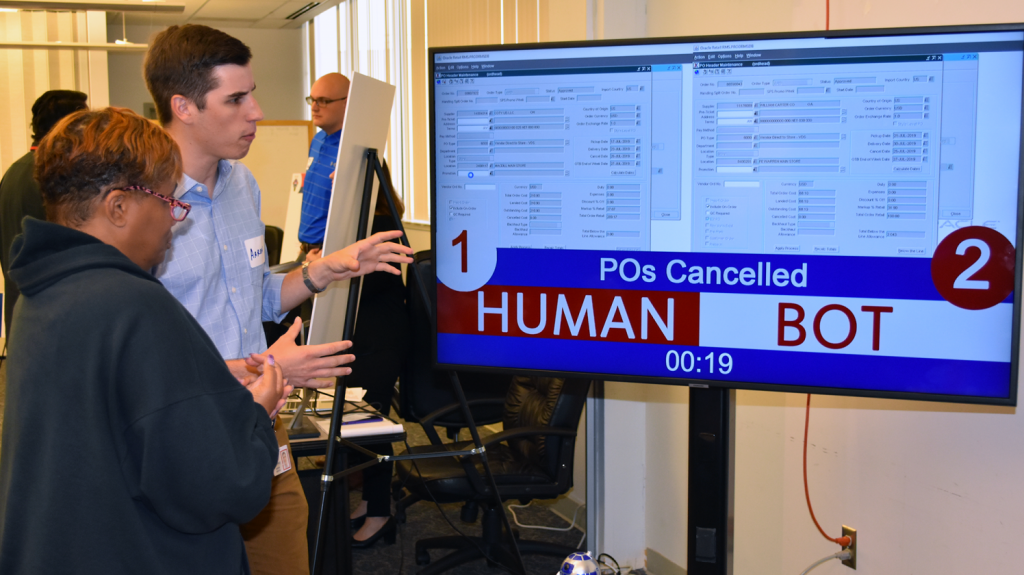 IT's Aaron Benton tells an associate about how bots can help humans do their work quicker and more efficiently.