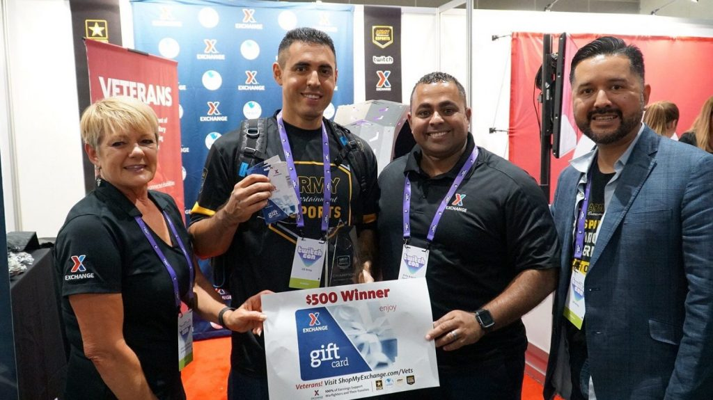 "Sgt. Dominic Ramirez took home the grand prize Sept. 27 at TwitchCon after battling against fellow Soldiers and Guard members during a ""Street Fighter 5"" competition. Ramirez, assigned to the Presidio of Monterey, won a $500 Army & Air Force Exchange Service gift card and a Gaemz prize package. From left: Sandi Lute, Exchange vice president for marketing and customer engagement; Ramirez; Jose Hernandez, Exchange veterans service organization/military service organization outreach manager; and Refugio Orozco, Army MWR sponsorship coordinator"