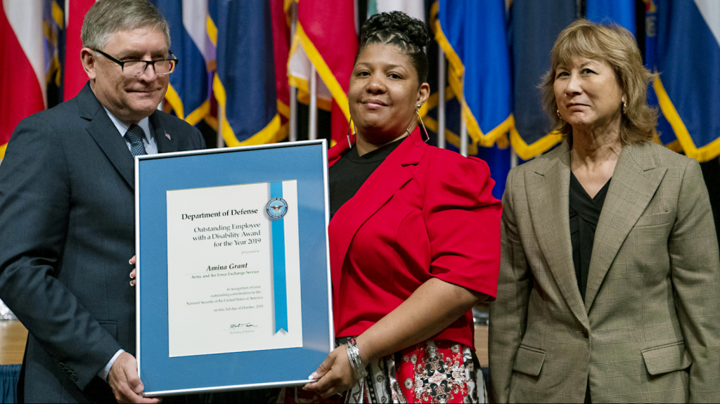 Exchange EVP and Chief Logistics Officer Karen Stack, right, joins Under Secretary of Defense for Personnel and Readiness James Stewart and Exchange associate Amina Grant at the awards ceremony.
