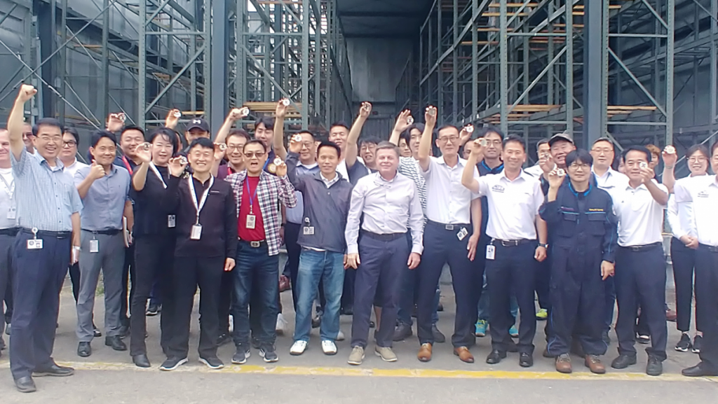 EVP and Chief Operating Officer Dave Nelson, center, with coin recipients and other members of the Korea Distribution Center.