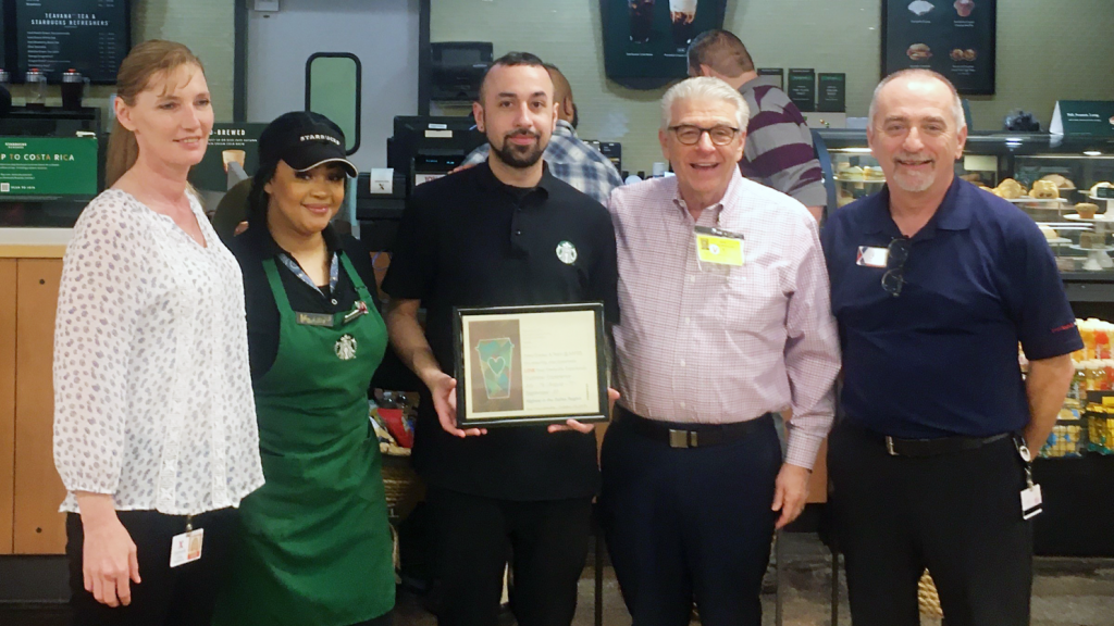 Left to right, Exchange manager Linda Densmore; Starbucks foremen Starbucks Foremen Kela Williams and Joseph Gomez; Starbucks District Manager Gus Dracopoulos; and Food Court Manager   Michael Blankenship.