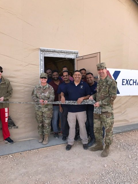 COL Scott McFarland, commander of the Exchange's Europe/Southwest Asia Region, helps cut the ribbon.