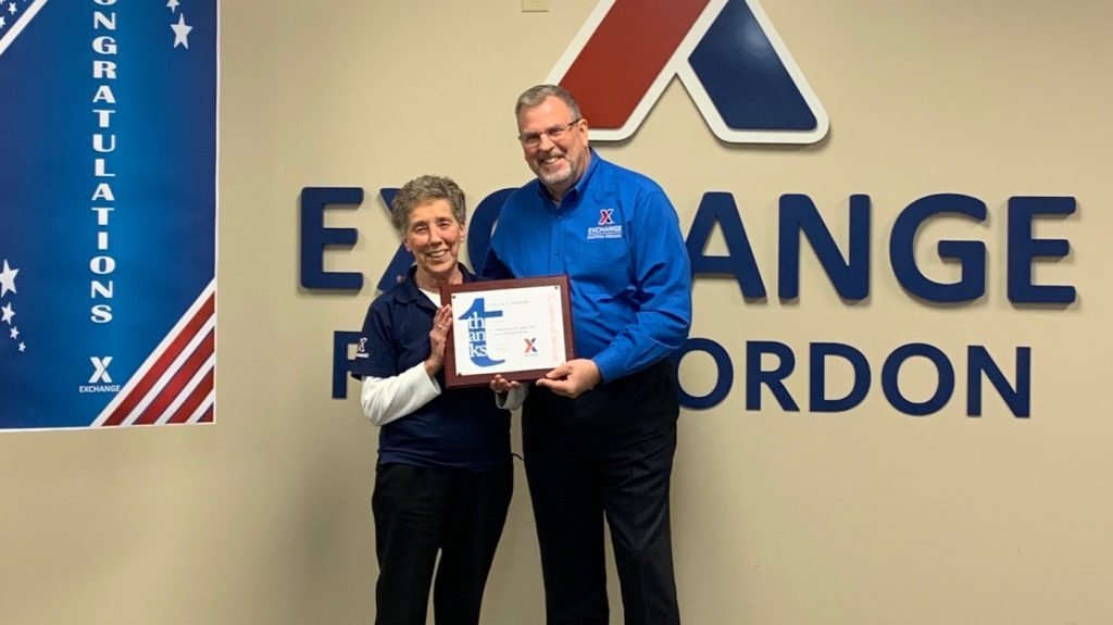 Eastern Region Senior Vice President Bob White presents associate Evelyn Huskins with her 50-year service award.