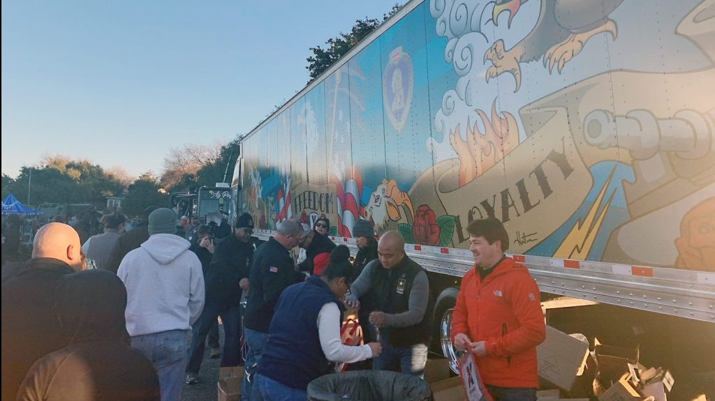 Before kickoff, fans picked up giveaways and took photos of the Exchange's new truck design, which features Americana-style artwork by Air Force and Marine Corps Veterans who work at the Exchange.