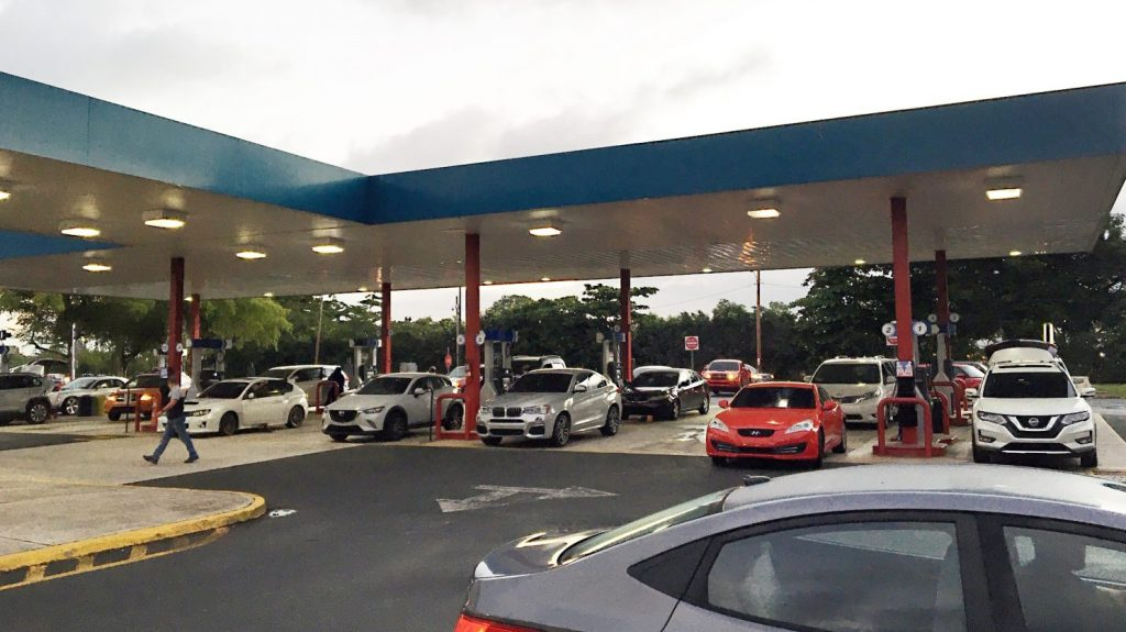 Drivers queue up to the Exchange gas pumps for fuel on the day the earthquake struck.