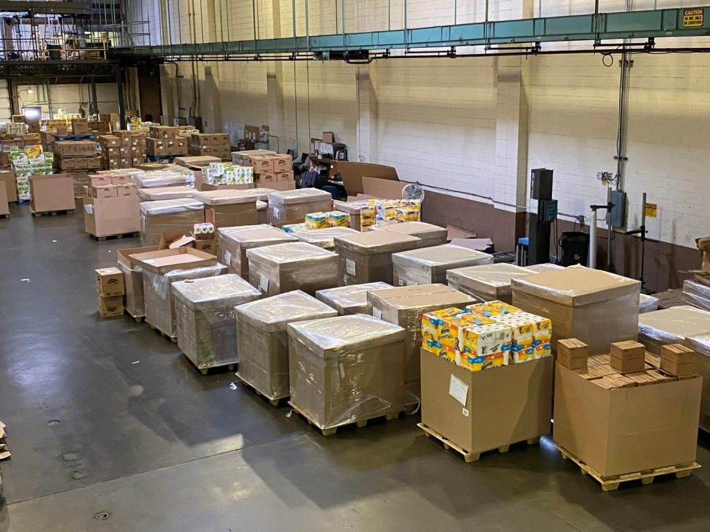 Containers of products are sorted at the Dan Daniel DC in Newport News, Va., for shipment to Exchanges.