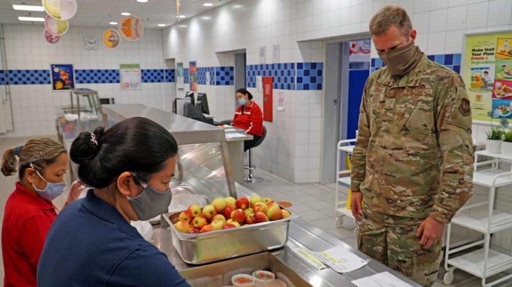 Exchange School Meal Program Food Server Emily Turner (left) and SMP Supervisor Ana Marie Kral, prepare a grab-and-go meal June 4, 2020 at Ramstein Intermediate School. (U.S. Army photo by Sgt. 1st Class Taresha Hill)