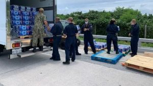 Exchange team unloads pallet of water