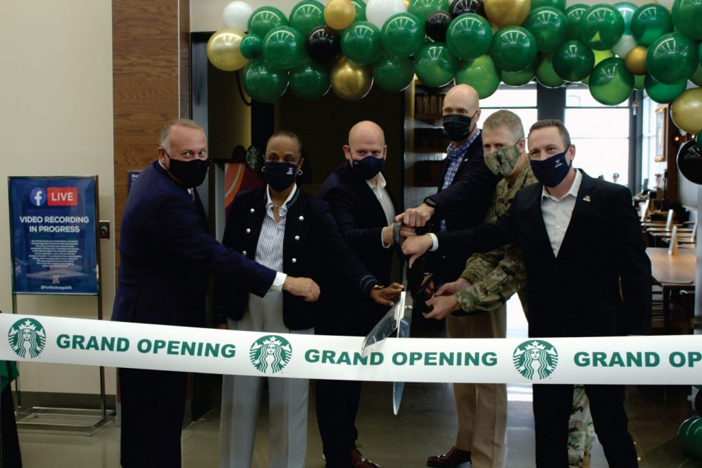 Army & Air Force Exchange Service and Starbucks officials cut the ribbon on the Exchange's 100th Starbucks retail licensed location Sept. 17 at Joint Base Lewis-McChord. From left, Ronny Rexrode, Vice President, Food and Theater Operations, Exchange; Shelly Armstrong, Western Region Senior Vice President, Exchange; Aaron Koransky, Vice President, Licensed Store Business Development, Operations & Strategy, Starbucks; Matt Kress, Senior Manager, Global Responsibility, Starbucks, Col. Skye Duncan, JBLM Garrison Commander; and Mike Einer, JBLM Exchange General Manager.
