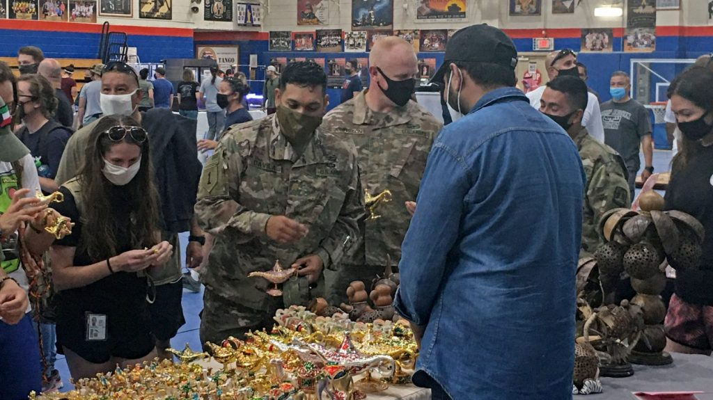 Service members peruse the wares of local vendors recently during a holiday shopping bazaar at Camp Arifjan in Kuwait.