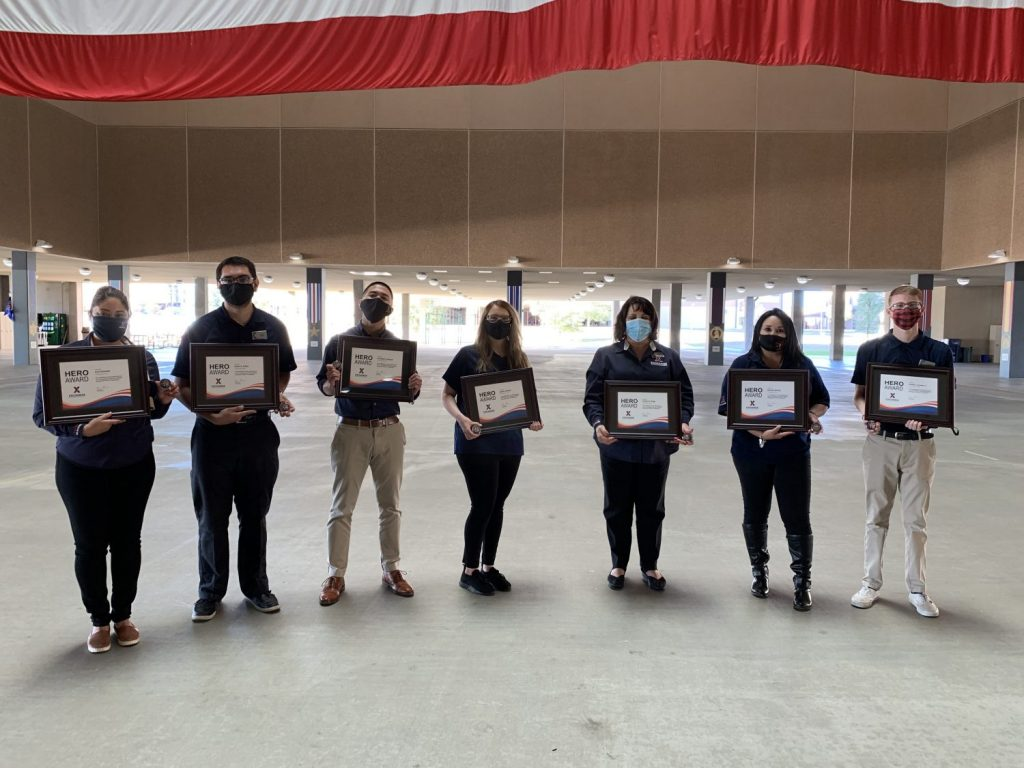 Joint Base San Antonio Exchange associates from the Lackland BMT Reception store receive Hero Awards.